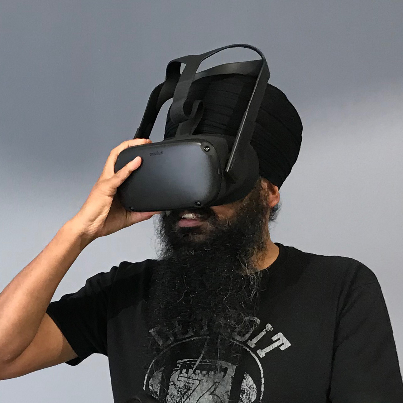 An image of the trainer Taran Singh. He is wearing a VR headset, has a beard and is wearing a turban